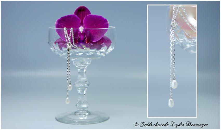 Silberkette geknotet und zwei Perlen
